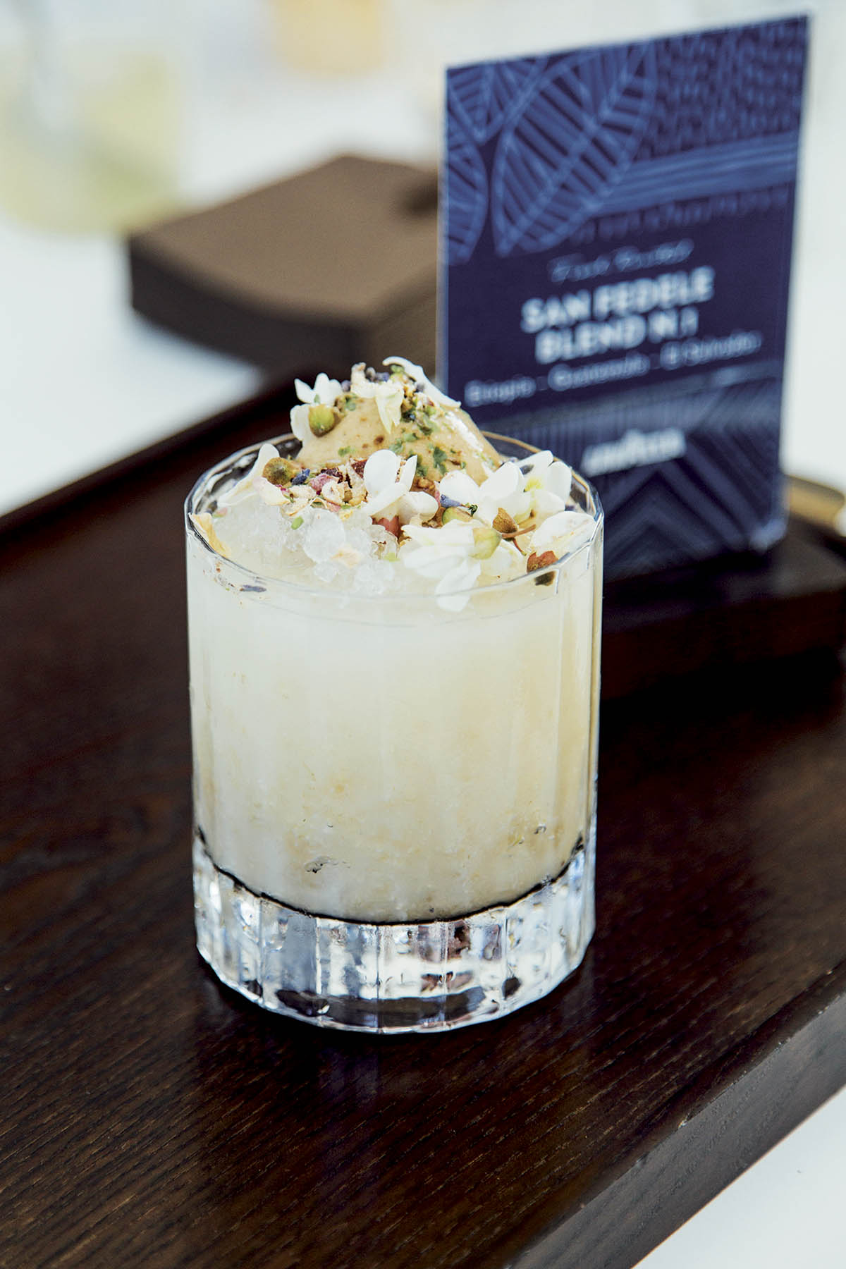 Coffee cocktail with acacia flowers
